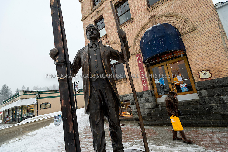 2/28/2013--Rossland, British Columbia, Canada..A statue of Olaus Jeldness on Columbia Ave. in Rossland; Jeldness, often seen as the father of skiing at Red Mountain. When he arrived back in the 1890's, there was no ski hill, no chair lift and no apres ski, and Olaus was one of the people who helped make the hill and the community what it is today. Jeldness pioneered the establishment of competitive skiing in western Canada. ..Red Mountain Resort has legendary steeps and tree-skiing,  ghostly empty slopes and the little village of Rossland at its foot, which Canada's Explore magazine called  the nation's No. 1 outdoors town. But for Americans Rossland isn't particularly near to anywhere, a 2.5-hour's drive due north of Spokane, Wash. in a region of B.C. known as the West Kootenays. In the autumn of 2012, though, the resort's owners embarked on the biggest ski-area expansion in North America in years. The growth spurt onto adjacent Grey Mountain has added nearly 1,000 acres of skiable terrain to the ski resort, accessed by a new chairlift that opens in the winter of 2013-2014. Skiable terrain has increased from 1,685 acres to 2,682 acres which suddenly lifts Red into the pantheon of North America's largest ski areas...©2013 Stuart Isett. All rights reserved.