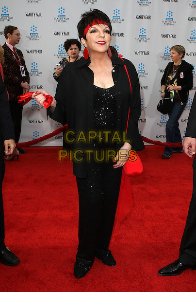 Liza Minnelli .2012 TCM Classic Film Festival Opening Night Gala Held at Grauman's Chinese Theatre, Hollywood, California, USA..April 12th, 2012.full length black red circle disc earrings suit headband jacket holding carrying gloves .CAP/ADM/KB.©Kevan Brooks/AdMedia/Capital Pictures.