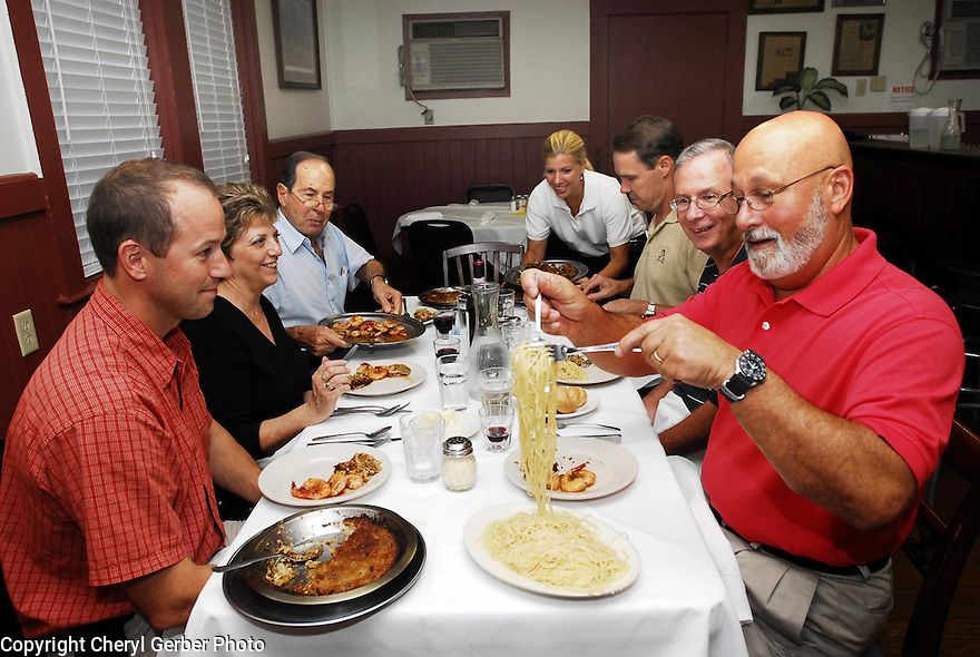 Customers dig in at Mosca's  restaurant in Avondale, Thur., Aug. 17, 2006..(Cheryl Gerber for New York Times)...