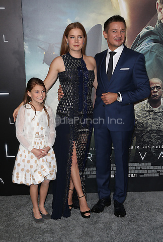"""Westwood, CA - NOVEMBER 06: Abigail Pniowsky, Amy Adams, Jeremy Renner at Premiere Of Paramount Pictures' """"Arrival"""" At Regency Village Theatre, California on November 06, 2016. Credit: Faye Sadou/MediaPunch"""