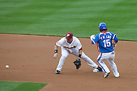 21 March 2009: #12 Marco Scutaro  of Venezuela fails to catch the ball as #15Yong-Kyu Lee of Korea runs during the 2009 World Baseball Classic semifinal game at Dodger Stadium in Los Angeles, California, USA. Korea wins 10-2 over Venezuela.