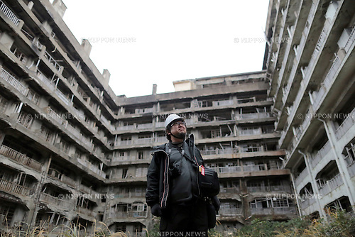 In this December 11, 2013 photo, director Shinji Higuchi poses in front of an abandoned apartment building during a location hunting for his film, &quot;Attack on Titan&quot; on Hashima Island, commonly known as Gunkanjima, which means &quot;Battleship Island&quot; off Nagasaki, Nagasaki Prefecture, southern Japan. <br /> (Photo by Yuriko Nakao/AFLO) (No Third Party Sales, Minimum $50.00 Per Image)