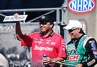 Aug. 21, 2011; Brainerd, MN, USA: NHRA funny car driver John Force (right) with Cruz Pedregon during the Lucas Oil Nationals at Brainerd International Raceway. Mandatory Credit: Mark J. Rebilas-