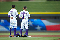 (L-R) Laz Rivera (16) and Nick Madrigal (4) of the Winston-Salem Dash stand for the National Anthem prior to the game against the Myrtle Beach Pelicans at BB&T Ballpark on August 6, 2018 in Winston-Salem, North Carolina. The Dash defeated the Pelicans 6-3. (Brian Westerholt/Four Seam Images)