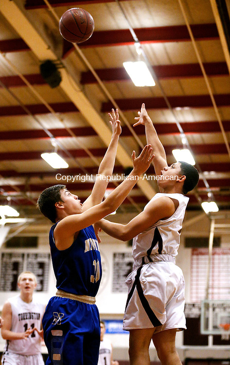 Torrington, CT- 11 January 2016-011116CM06-Torrington's David White shoots over Newtown's Tom Cotton during their non-conference matchup in Torrington on Monday.      Christopher Massa Republican-American