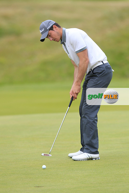 Jeff Hopkins (The Royal Dublin) on the 15th green during Matchplay Round 4 of the South of Ireland Amateur Open Championship at LaHinch Golf Club on Saturday 25th July 2015.<br /> Picture:  Golffile | TJ Caffrey