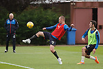 Kenny Miller hooks the ball over his head