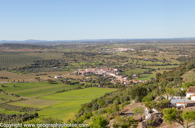 View over landscape from village of Monsaraz, Alto Alentejo, Portugal, southern Europe view north over countryside fields, villages and farms of Montado farming with oak trees