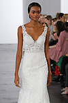 Model walks runway in a sweetheart sleeveless fit and flare bridal gown with beaded belt, from the Dennis Basso for Kleinfeld 2018 Bridal Collection on October 5 2017, during New York Bridal Fashion Week.