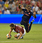 Fabio Borini (11, left) of Milan and Renato Sanches (35) of Bayern Munich collide and fall during their International Champions Cup match on July 23, 2019 at Children's Mercy Park in Kansas City, KS.<br /> Tim VIZER/AFP