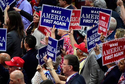 People wave signs at the 2016 Republican National Convention held at the Quicken Loans Arena in Cleveland, Ohio on Wednesday, July 20, 2016.<br /> Credit: Ron Sachs / CNP<br /> (RESTRICTION: NO New York or New Jersey Newspapers or newspapers within a 75 mile radius of New York City)