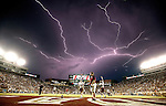 After an hour long weather delay, a lightning strike occures as Texas State warms up in Doak Campbell Stadium prior to an NCAA college football game against Florida State in Tallahassee, Fla., Saturday, Sept. 5, 2015. (AP Photo/Mark Wallheiser)