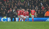 Simon Church of Wales (second left) is mobbed after scoring his side's equalising goal from the penalty spot during the International Friendly match between Wales and Northern Ireland at Cardiff City Stadium, Cardiff, Wales on 24 March 2016. Photo by Mark  Hawkins / PRiME Media Images.