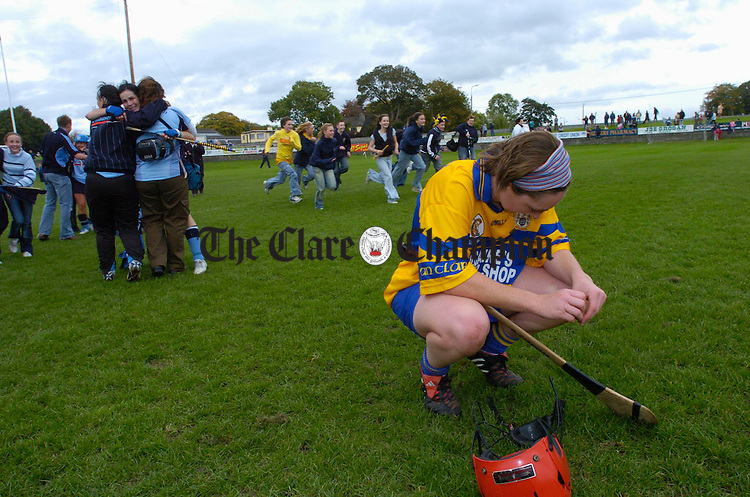Dublin celebrate as a dissapointed Clare player Deirdre Corcoran hangs her head following the All Ireland camogie final replay at Birr. Photograph by John Kelly.