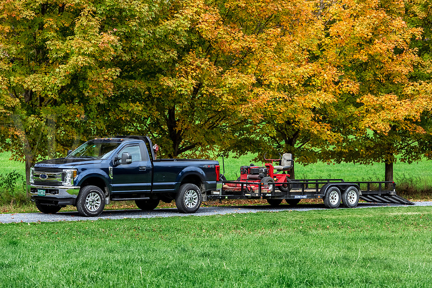 Lawn care service truck and lawn mower.