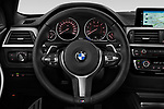 Car pictures of steering wheel view of a 2017 BMW 4 Series Gran Coupe M Sport 5 Door Hatchback