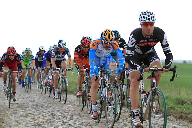 The riders tackle the 1st section of cobbled pave at Troisvilles a Inchy during the Paris-Roubaix pro cycle race, 11th April 2010 (Photo by Eoin Clarke/NEWSFILE).
