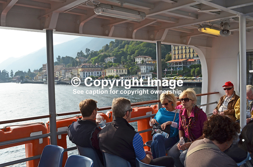 Cruising Como, Italy, in one of the many small ferry boats that criss-cross the lake is a great way to see and visit the many small picturesque towns. 201410043711<br /> <br /> Copyright Image from Victor Patterson, 54 Dorchester Park, Belfast, UK, BT9 6RJ<br /> <br /> t: +44 28 9066 1296<br /> m: +44 7802 353836<br /> vm +44 20 8816 7153<br /> <br /> e1: victorpatterson@me.com<br /> e2: victorpatterson@gmail.com<br /> <br /> www.victorpatterson.com<br /> <br /> IMPORTANT: Please see my Terms and Conditions of Use at www.victorpatterson.com