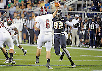 Florida International University football player defensive lineman Paul Crawford (92) plays against Troy University on October 26, 2011 at Miami, Florida. FIU won the game 23-20 in overtime. .