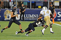 17 September 2011:  FIU defensive back Sam Miller (39) tackles UCF wide receiver Quincy McDuffie (14) during the opening play of the second half as the FIU Golden Panthers defeated the University of Central Florida Golden Knights, 17-10, at FIU Stadium in Miami, Florida.