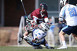 14 February 2015: UMass's Charlie Schatz (6) and North Carolina's Stephen Kelly (24) get tangled up while challenging for a faceoff. The University of North Carolina Tar Heels hosted the University of Massachusetts Minutemen in a 2015 NCAA Division I Men's Lacrosse match. UNC won the game 20-8.
