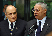 United States Secretary of State Colin Powell, right, and former New York Mayor Rudy Giuliani, left, make departure statements after their meeting at the State Department in Washington, DC on June 13, 2003. Powell announced Giuliani will lead a Bush administration delegation to a conference called to address rising incidents of anti-semitism in Europe.  .Credit: Ron Sachs / CNP.(RESTRICTION: NO New York or New Jersey Newspapers or newspapers within a 75 mile radius of New York City)
