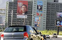 A huge banner with the face of Venezuelan President Hugo Chavez is displayed in the facade of the UNEFA, an University property of the venezuelan Army, as vehicles ride through the highway in Caracas, Venezuela, on Saturday, Jul. 08, 2006. (ALTERPHOTOS/Alvaro Hernandez)
