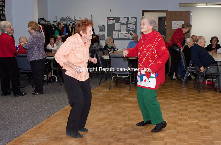 TORRINGTON CT-DECEMBER 11 2013 121113DA01- Shirley Hartenthaler, left, and Barbara Danaher, right, dance to the music of Vinnie Carr during the Sullivan Senior Center Christmas Party in Torrington on Wednesday. Along with Vinnie Carr the event provided the Silver Bells and Beaux singing Christmas carols, lunch, dessert, and door prizes.<br /> Darlene Douty Republican American