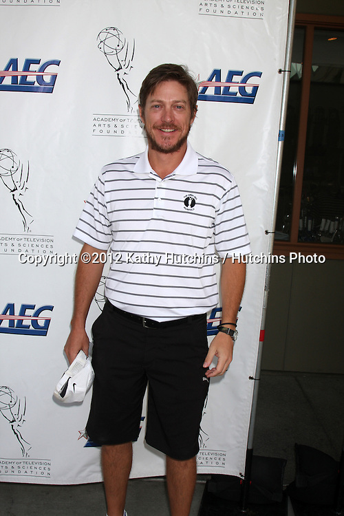 LOS ANGELES - SEP 10:  Kevin Rahm arrives at the 13TH PRIMETIME EMMY CELEBRITY TEE-OFF at Oakmont Country Club on September 10, 2012 in Glendale, CA