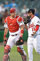 Peoria Chiefs catcher Carson Kelly (19) talks with pitcher Rob Kaminsky (33) as they walk to the dugout in between innings during a game against the Kane County Cougars on June 2, 2014 at Dozer Park in Peoria, Illinois.  Peoria defeated Kane County 5-3.  (Mike Janes/Four Seam Images)