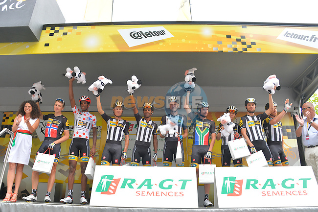 MTN-Qhubeka lead the team classification, on the podium before the start of Stage 8 of the 2015 Tour de France running 181.5km from Rennes to Mur de Bretagne, France. 10th July 2015.<br /> Photo: ASO/B.Bade/Newsfile