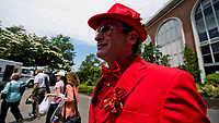 ELMONT, NY - JUNE 10: A man wears an all red suit and tie on Belmont Stakes Day at Belmont Park on June 10, 2017 in Elmont, New York (Photo by Scott Serio/Eclipse Sportswire/Getty Images)