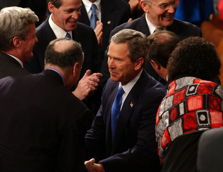 union28/012803 -- President George W. Bush is greeted on his way onto the House Floor before the State of the Union Address, Tuesday, Jan. 28, 2003.