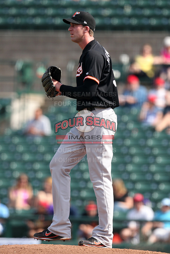 Norfolk Tides relief pitcher Mark Hendrickson #30 during a game against the Rochester Red Wings at Frontier Field on June 5, 2011 in Rochester, New York.  Norfolk defeated Rochester 11-5 in eleven innings.  Photo By Mike Janes/Four Seam Images