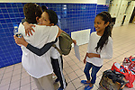 Grace Hernandez (left) hugs Dayanara Lopez and her son Josue Isaac as she says goodbye to the woman and her children in the Greyhound Bus Station in San Antonio, Texas, on December 3, 2015. Looking on is Lopez' daughter Genesis. Lopez and her children, along with two teenage nephews, fled Honduras in October 2015 because of domestic violence and threats and assaults against her nephews from gangs. After requesting political asylum in the United States, they were held for several days by immigration officials and then released. The nephews were turned over to their mother, who already lived in the U.S. Lopez and her children stayed at first in a shelter run by the Refugee and Immigrant Center for Education and Legal Services (RAICES) and supported by a coalition of San Antonio churches. They then traveled by bus to another location in the U.S. while they await a final decision on their asylum petition. Hernandez is a volunteer with RAICES.