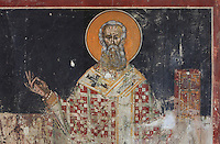 Fresco of man with a halo holding a bible, repainted in 1591 at the behest of the priest father Konstandin and his brothers Dimitre and Jan, in the Cathedral of St Nicholas inside Berat Castle or Kalaja e Beratit, in Berat, South-Central Albania, capital of the District of Berat and the County of Berat. Picture by Manuel Cohen
