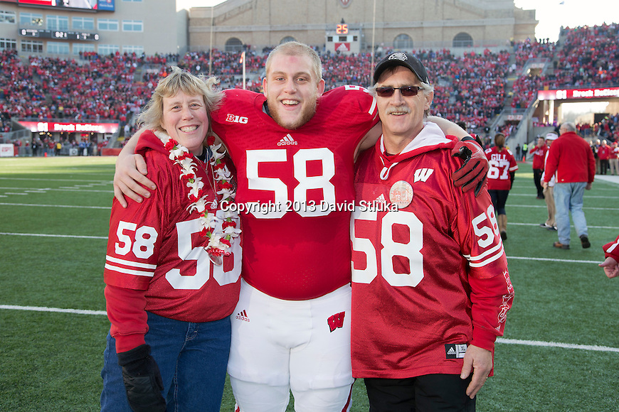 Wisconsin Badgers senior Jacob Ninneman (58) with his parents prior to an NCAA Big Ten Conference Football game against the Penn State Nittany Lions Saturday, November 30, 2013, in Madison, Wis. The Nittany Lions won 31-24. (Photo by David Stluka)
