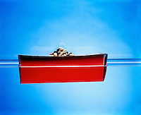 BUOYANCY: BOAT FILLED WITH BEANS (2 of 5)<br /> Adding More Beans Causes The Boat To Drop<br /> The greater the volume of an object, the more water it displaces &amp; the greater the buoyant force on it. When the buoyant force equals the weight of the object, the object floats. Addition of more beans increases the weight of the boat causing it to drop.