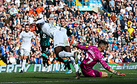 Leeds United's Eddie Nketiah heads at goal under pressure from Swansea City's Freddie Woodman<br /> <br /> Photographer Alex Dodd/CameraSport<br /> <br /> The EFL Sky Bet Championship - Leeds United v Swansea City - Saturday 31st August 2019 - Elland Road - Leeds<br /> <br /> World Copyright © 2019 CameraSport. All rights reserved. 43 Linden Ave. Countesthorpe. Leicester. England. LE8 5PG - Tel: +44 (0) 116 277 4147 - admin@camerasport.com - www.camerasport.com