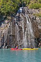 Tourists enjoy kayaking in Harriman Fjord, northern Prince William Sound, southcentral, Alaska.