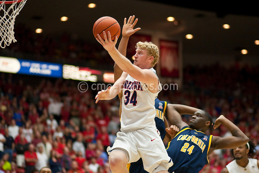 Mar 5, 2009; Tucson, AZ, USA; Arizona Wildcats forward Chase Budinger (34) shoots in front of California Golden Bears forward Theo Robertson (24) in the second half of a game at the McKale Center.  Cal defeated Arizona 83-77.