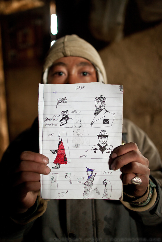 The son of Abdul Haq proudly shows me a drawing illustrating Abdul Rashid Khan (the late Khan of the Kyrgyz comunity), a warlord Commander, an Afghan policeman and Kyrgyz women. Andemin camp..Home of Abdul Haq. At the Andemin camp...Trekking through the high altitude plateau of the Little Pamir mountains, where the Afghan Kyrgyz community live all year, on the borders of China, Tajikistan and Pakistan.