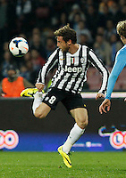 Claudio Marchisio     in action during the Italian Serie A soccer match between SSC Napoli and Juventus FC   at San Paolo stadium in Naples, March 30 , 2014