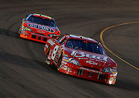 Apr 22, 2006; Phoenix, AZ, USA; Nascar Nextel Cup driver Dale Earnhardt Jr. of the (8) Budweiser Chevrolet Monte Carlo leads Jeff Gordon during the Subway Fresh 500 at Phoenix International Raceway. Mandatory Credit: Mark J. Rebilas-US PRESSWIRE Copyright © 2006 Mark J. Rebilas..