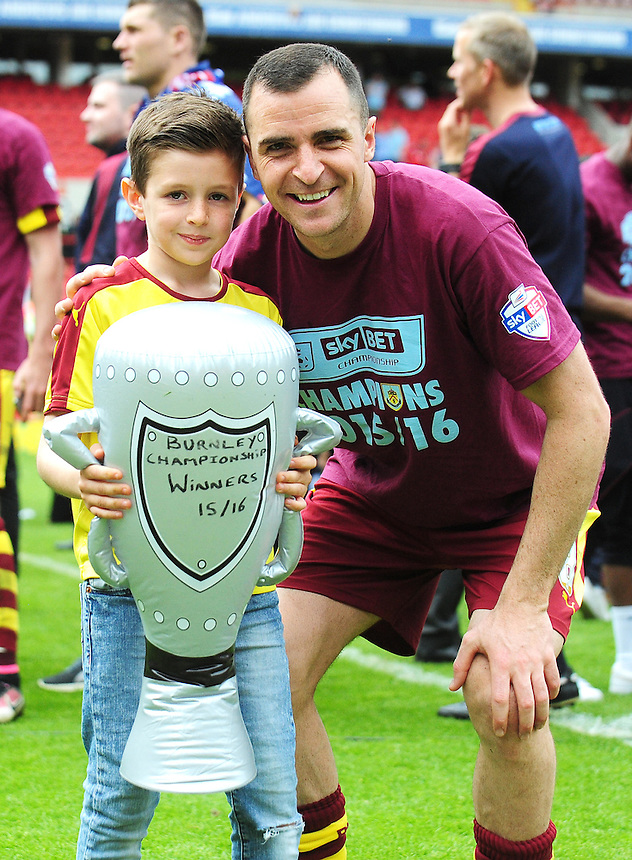 Burnley's Dean Marney celebrates his side becoming champions of the Sky Bet Championship with his son<br /> <br /> Photographer Kevin Barnes/CameraSport<br /> <br /> Football - Sky Bet Football League Championship - Charlton Athletic v Burnley - Saturday 7th May 2016 - The Valley - London<br /> <br /> &copy; CameraSport - 43 Linden Ave. Countesthorpe. Leicester. England. LE8 5PG - Tel: +44 (0) 116 277 4147 - admin@camerasport.com - www.camerasport.com
