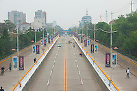 Daytime horizontal view from a train of a boulevard near Píngyáo county of the Jìnzhōng District in Shānxī Province, China  © LAN