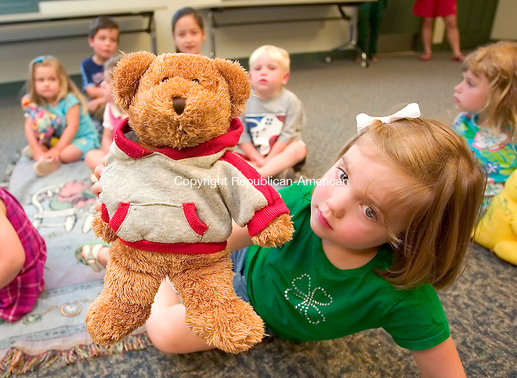 SOUTHBURY, CT. 25 June 2007-062507SV03--Molly Flanagan, 5, of Southbury shows off her teddy bear &quot;Rosie&quot; during the Southbury Public Library's annual Teddy Bear Picnic in Southbury Monday.<br /> Steven Valenti Republican-American