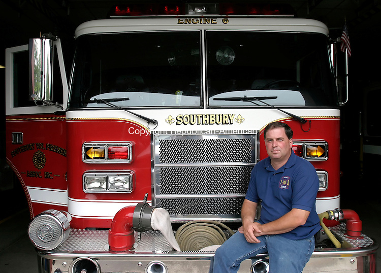 SOUTHBURY, CT, 13 July 2006- 071306BZ01- Southbury Volunteer Firemen's Association chief Lyman Gilbert poses with Engine 6 at the Southbury Center Firehouse Thursday.<br /> Jamison C. Bazinet Republican-American