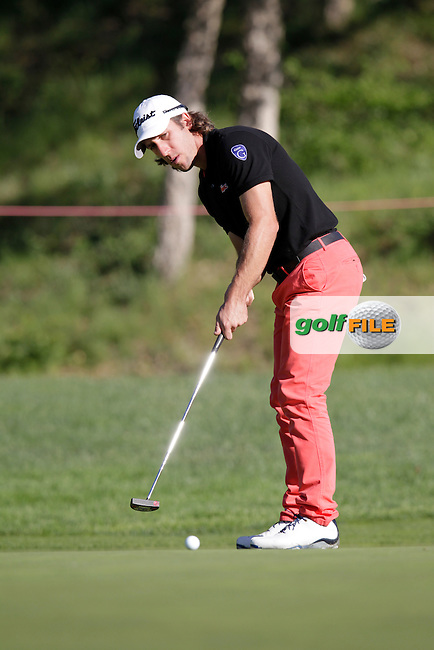 Romain Wattel (FRA) takes his putt on the 1st green during Thursday's Round 1 of the 2014 Open de Espana held at the PGA Catalunya Resort, Girona, Spain. Wednesday 15th May 2014.<br /> Picture: Eoin Clarke www.golffile.ie