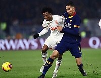 12th January 2020; Stadio Olympico, Rome, Italy; Italian Serie A Football, Roma versus Juventus; Juan Cuadrano of Juventus holds off Chris Smalling of AS Roma - Editorial Use